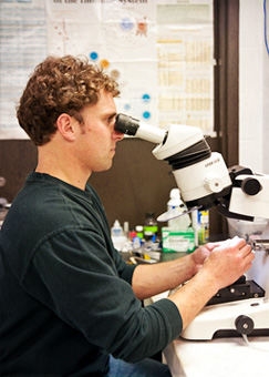 dude working at microscope